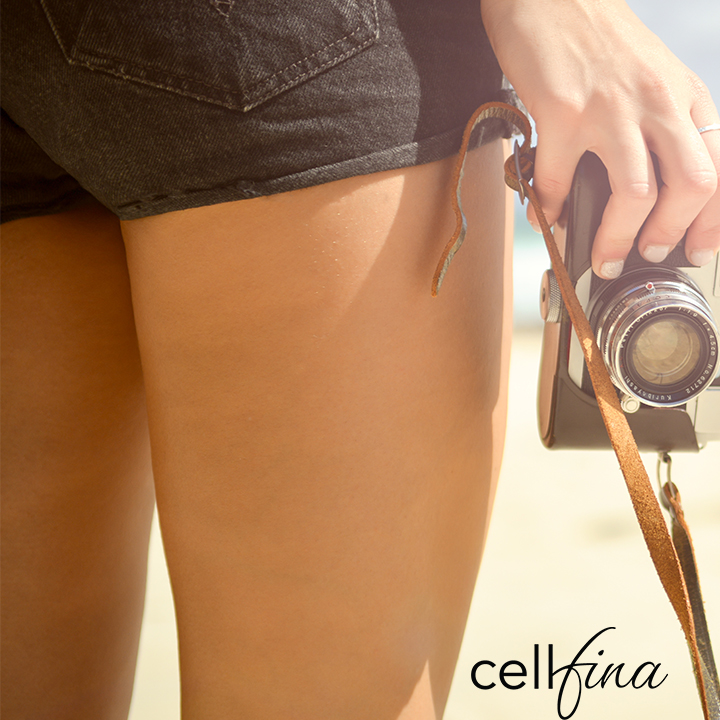 Woman in Shorts with a Camera